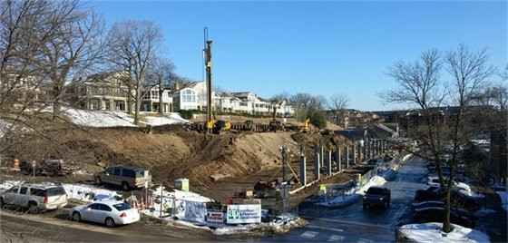 View from Broadway Ave - The crane continues the installation of support columns for the retaining wall.