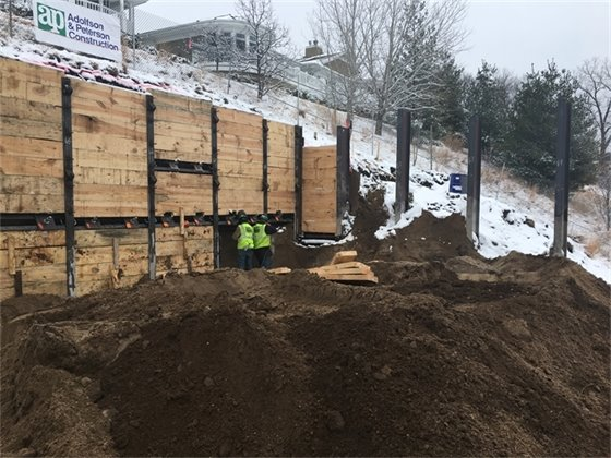 Installation of the wood lagging and tiebacks along the north side of the site.