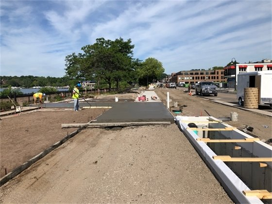 Pouring concrete walks at the Lake Street Plaza Park