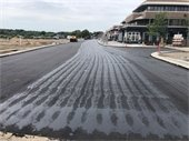 New pavement on Lake Street at the corner of Broadway Avenue