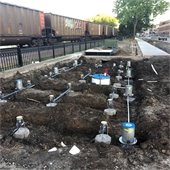 Underground plumbing and wiring for the interactive water feature, just south of Walker Avenue