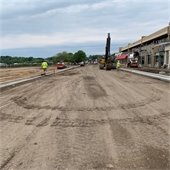Grading for sidewalks and Plaza Park features, looking west on Lake Street