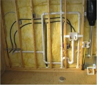 An exposed plumbing system in a wall