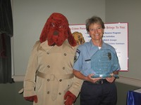 McGruff presenting an award to a police officer