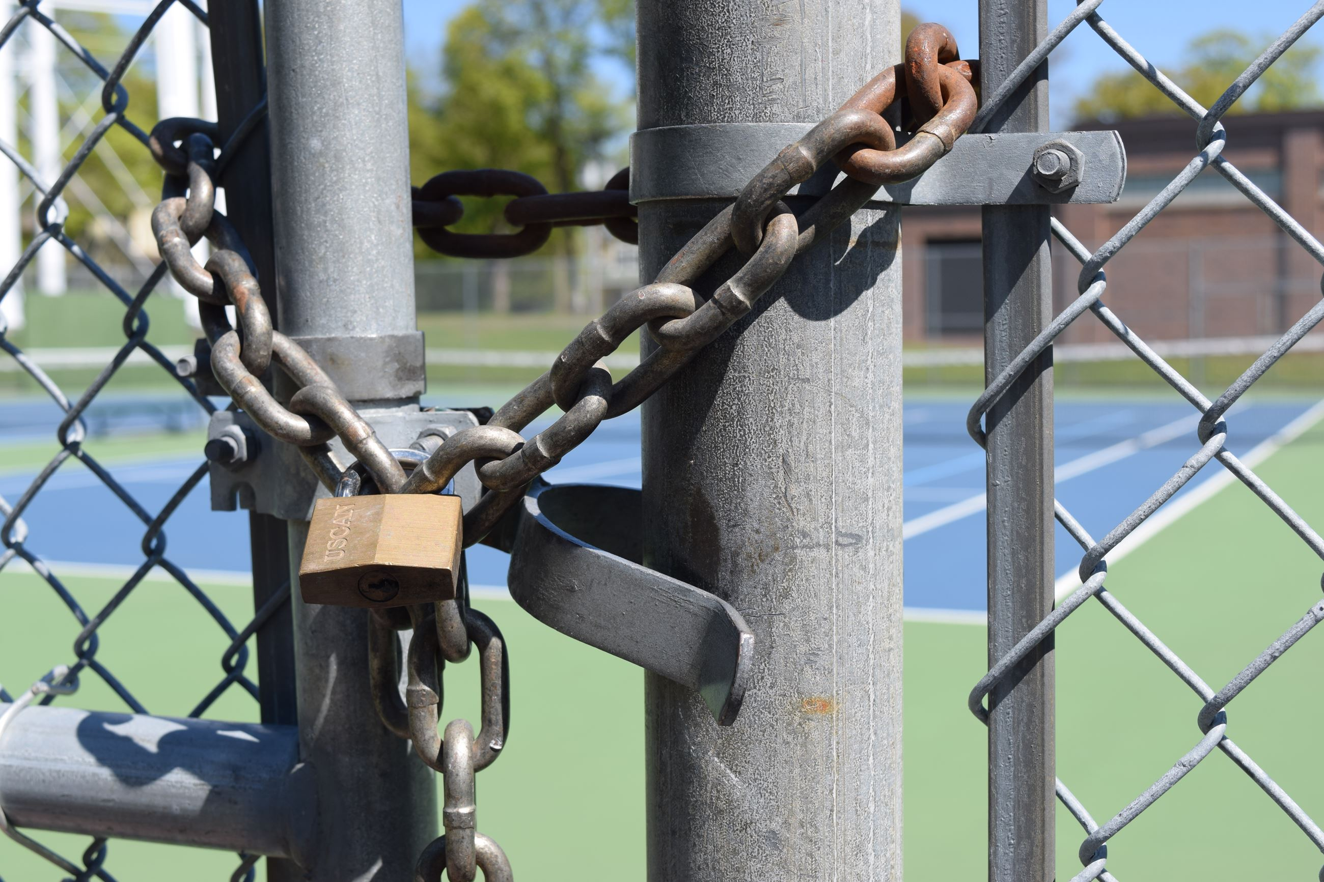 Chain and lock on tennis court gate